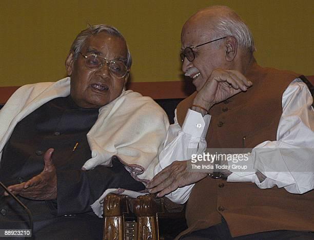 Former Prime Minister Atal Bihari Vajpayee talks to former home minister of India Lal Krishna Advani at VP House New Delhi where BJP senior leader...