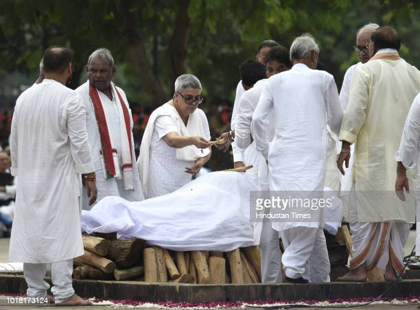 Former Prime Minister Atal Bihari Vajpayee's daughter Namita Kaul Bhattacharya and other family members perform last rites during his cremation...