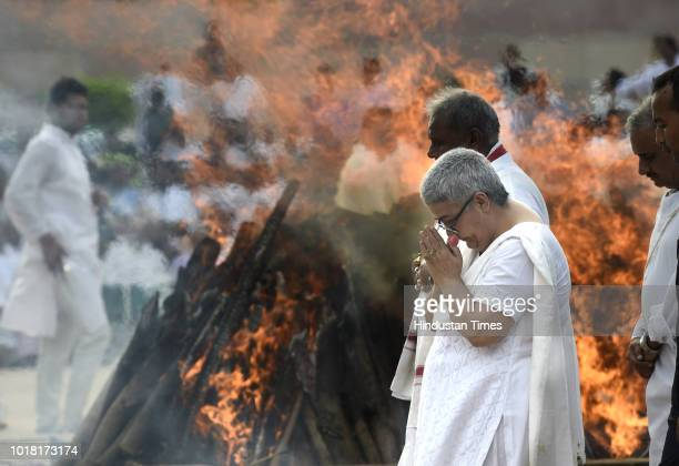 Former Prime Minister Atal Bihari Vajpayee's daughter Namita Kaul Bhattacharya and other family members during his cremation at Rashtriya Smriti...