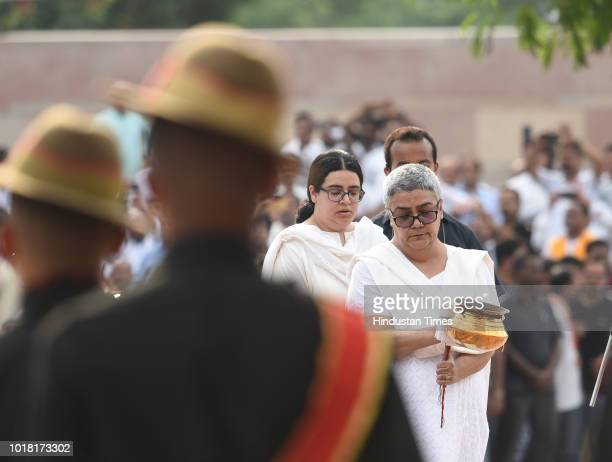 Former Prime Minister Atal Bihari Vajpayee's daughter Namita Kaul Bhattacharya and granddaughter Niharika Bhattacharya perform rituals during his...