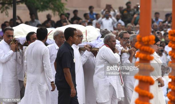 Former Prime Minister Atal Bihari Vajpayee's family members perform rituals during his cremation ceremony at Rashtriya Smriti Sthal on August 17 2018...