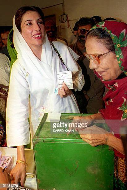 Former Prime Minister Benazir Bhutto of the Pakistan People's Party shows her ballot before voting 06 October 1993 Bhutto said 'I am quiet calm and...