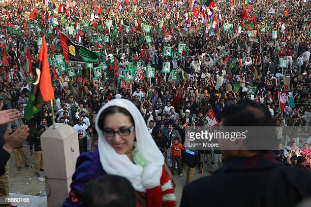 Former Prime Minister Benazir Bhutto prepares to address thousands of supporters at a campaign rally minutes before being assassinated in a bomb...