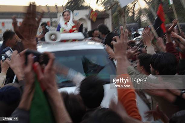 Former Prime Minister Benazir Bhutto waves from her car just seconds before being assassinated in a bomb attack following a political rally December...