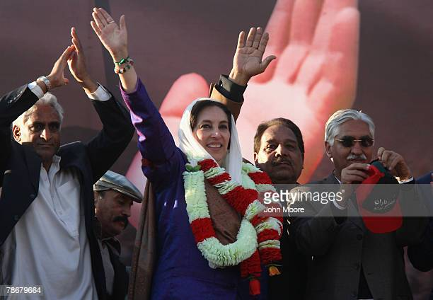 Former Prime Minister Benazir Bhutto waves to supporters at a campaign rally December 27 2007 in Rawalpindi Pakistan She was assassinated as she left...
