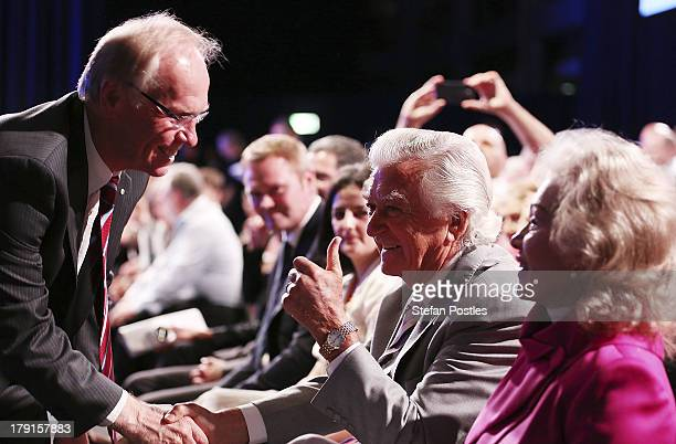 Former Prime Minister Bob Hawke shakes hands with Peter Beattie at the Labor Party Launch at the Brisbane Convention and Exhibition Centre on...