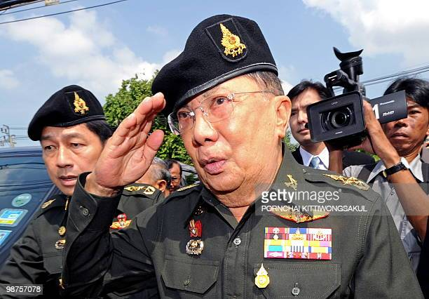 Former Prime Minister Chavalit Yongchaiyudh salutes as he arrives at a military base in Bangkok on April 30 2010 Chavalit submited a letter to the...