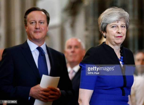 Former Prime Minister David Cameron and crurrent Prime Minister, Theresa May attend a service of thanksgiving to remember the life of Lord Jeremy...