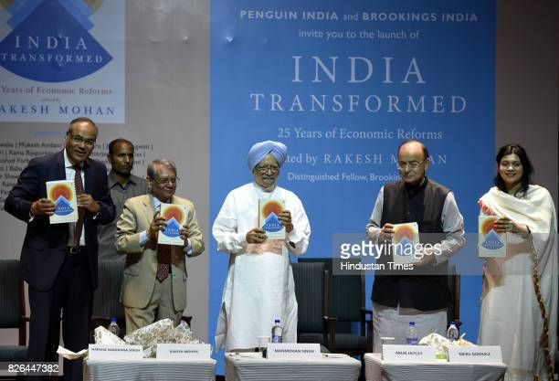Former Prime Minister Dr Manmohan Singh and Union Finance Minister Arun Jaitley with Harsha Vardhan Singh Rakesh Mohan Meru Gokhale launched a book...