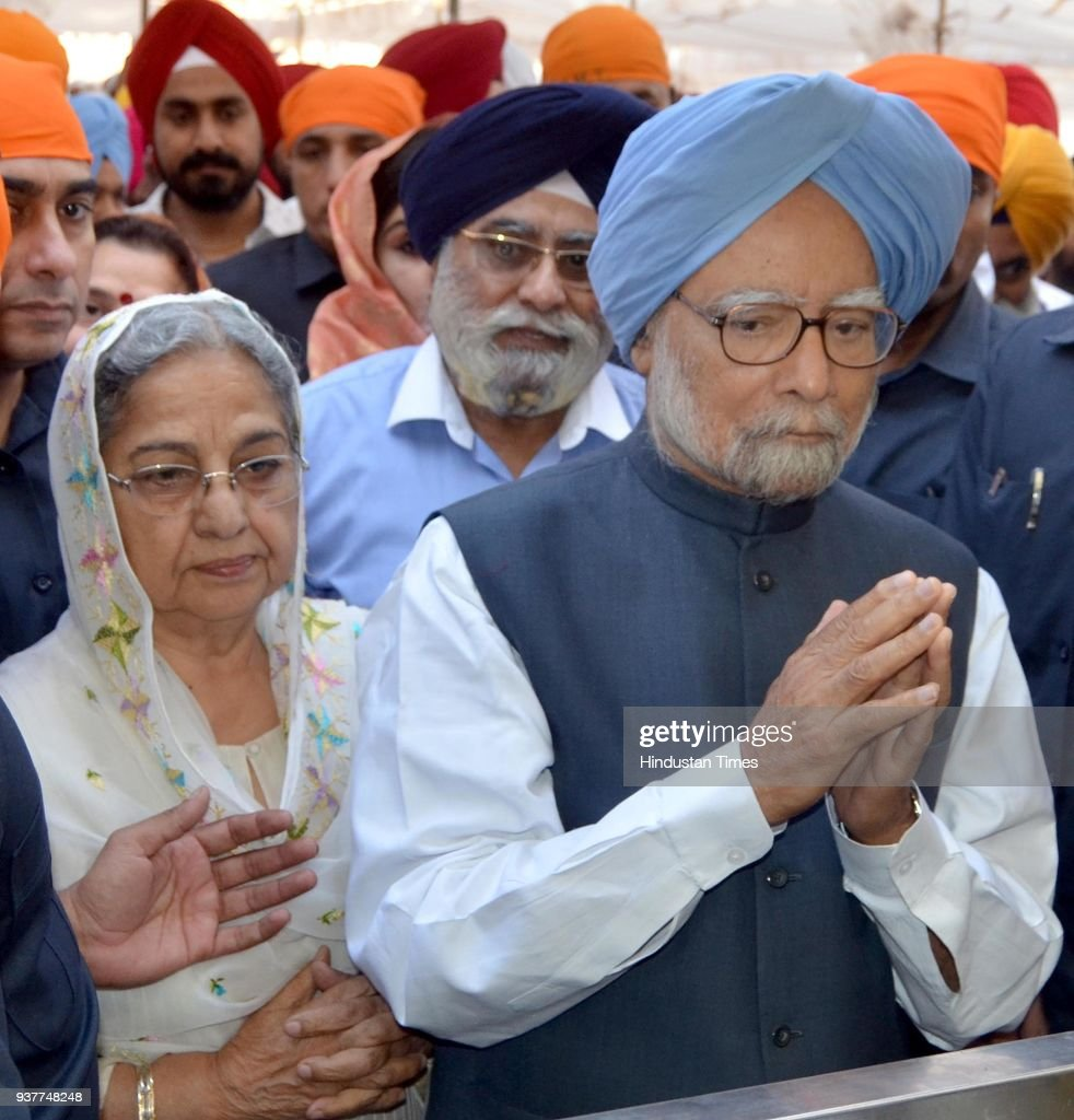 Former Prime Minister Dr Manmohan Singh with wife Gursharan Kaur paying obeisance at Golden Temple on March 25 2018 in Amritsar India On Saturday the.