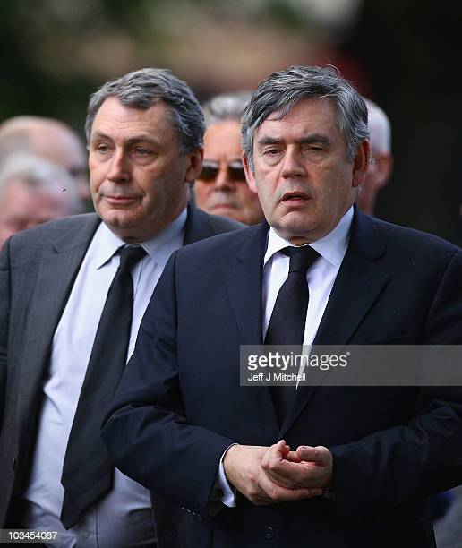 Former Prime Minister Gordon Brown and his brother John Brown arrive at the funeral of shipyard and trade union icon Jimmy Reid at Govan Old Parish...