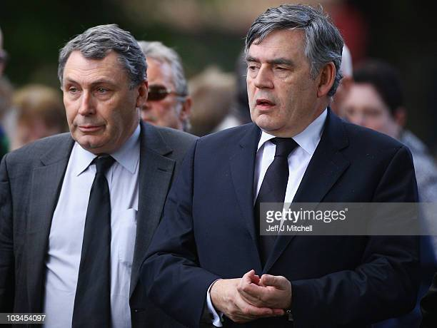 Former Prime Minister Gordon Brown and his brotherJohn Brown arrive at the funeral of shipyard and trade union icon Jimmy Reid at Govan Old Parish...