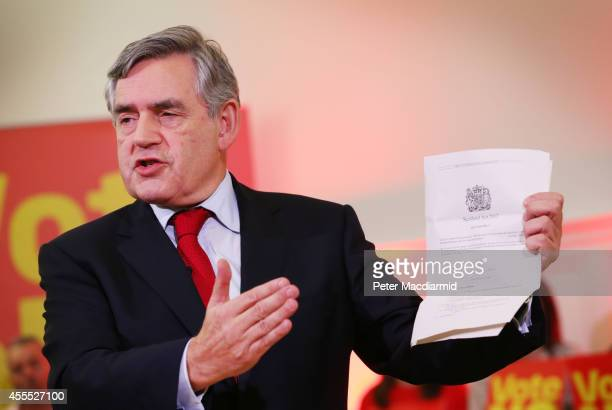 Former Prime Minister Gordon Brown holds up a copy of The Scotland Act as he speaks at Dumbarton Town hall to No campaigners on September 16 2014 in...