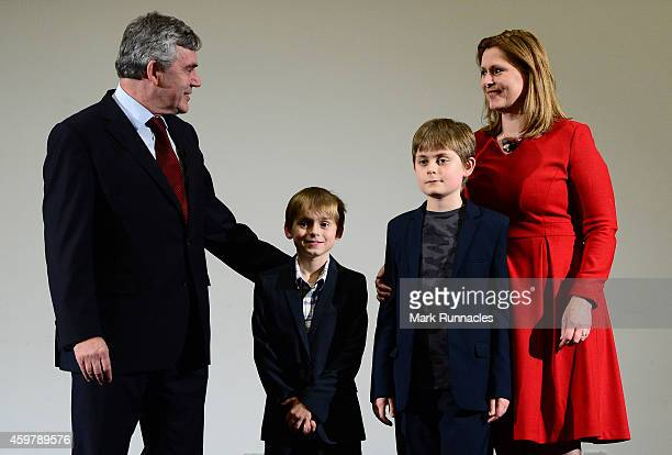 Former Prime Minister Gordon Brown with his wife Sarah and children James and John during a press conference to announce he is standing down as an MP...