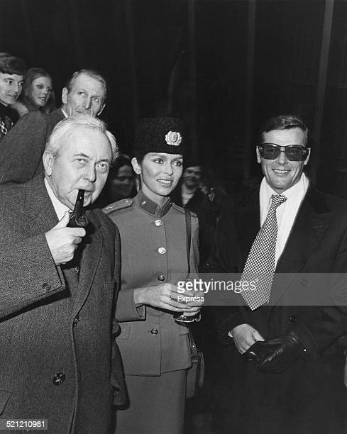 Former Prime Minister Harold Wilson meets American actress Barbara Bach and British actor Roger Moore at Pinewood Studios UK on the set of the James...