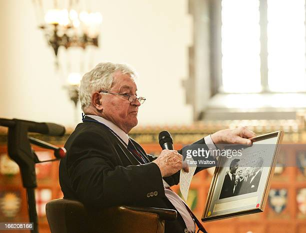 Former Prime Minister John Turner holds a photo of himself and Lester B Pearson during a lunchin engagement Tuesday April 9 2013 at the University of...