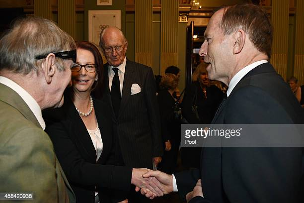Former Prime Minister Julia Gillard is greeted by Prime Minister Tony Abbott following the state memorial service for former Australian Prime...
