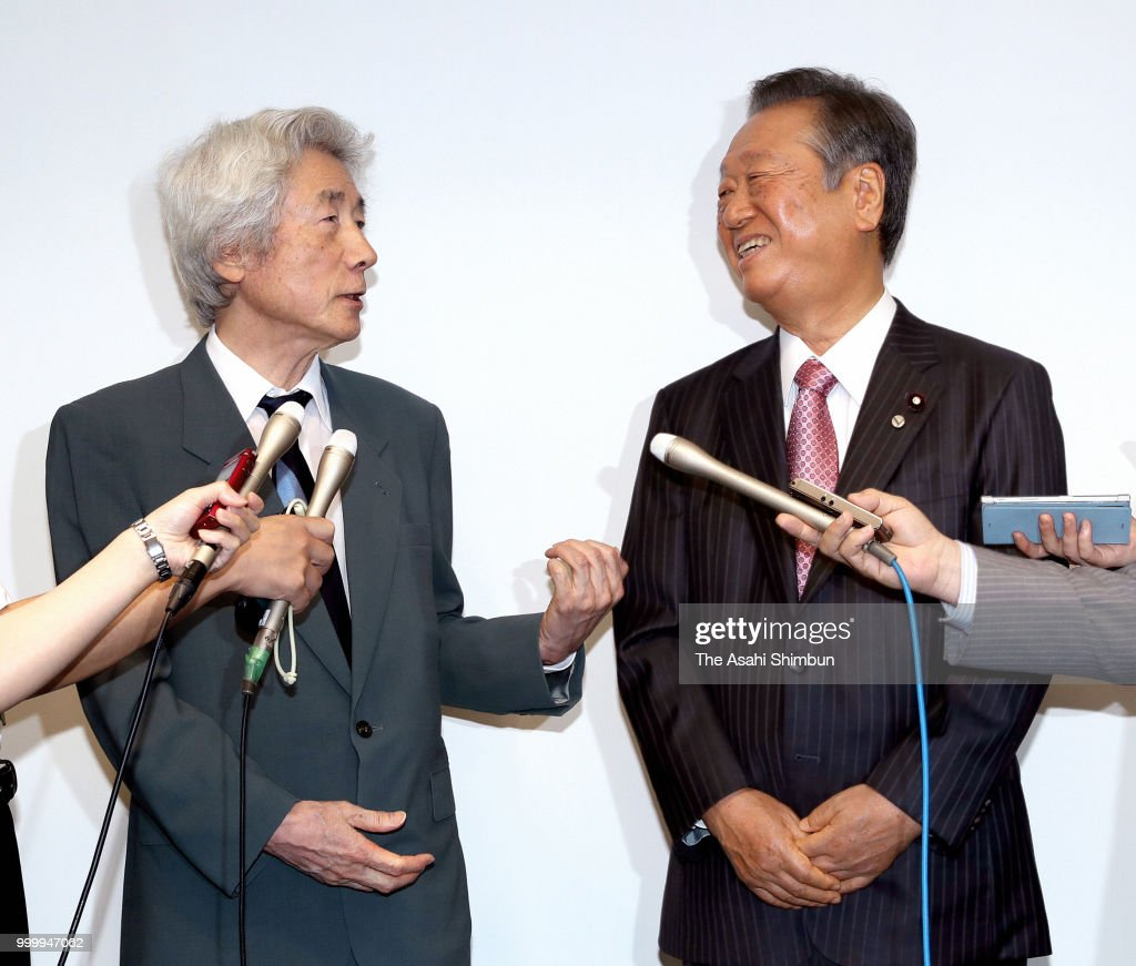 Former Prime Minister Junichiro Koizumi and Liberal Party leader Ichiro Ozawa talk to media reporters after addressing at a political school hosted by Ozawa on July 15, 2018 in Tokyo, Japan.