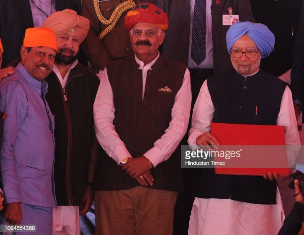 Former prime minister Manmohan singh along with governor VP Singh Badnaur and chief minsiter Capt Amarinder Singh releasing a book on Sikhs written...