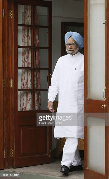 Former Prime Minister Manmohan Singh coming out after launching an online and applicationbased membership drive at his residence on March 30 2015 in...