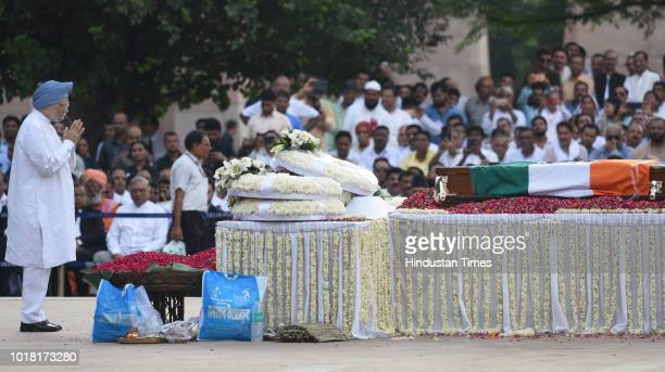 Former Prime Minister Manmohan singh pays his final respects during the cremation ceremony of former Prime Minister Late Atal Bihari Vajpayee at...