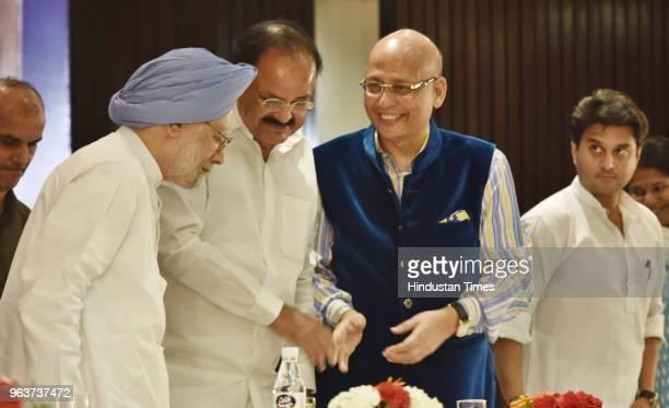 Former Prime Minister Manmohan Singh Vice President of India M Venkaiah Naidu and Congress leader Abhishek Manu Singhvi enjoys a light moment as...