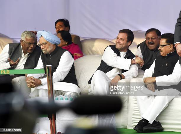 Former Prime Minister Manmohan Singh with left party leader D Raja Congress President Rahul Gandhi with Congress leader PL Punia before pays tribute...