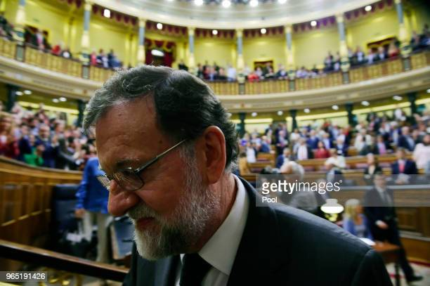 Former Prime Minister Mariano Rajoy leaves parliament after Sanchez won the noconfidence motion at the Lower House of the Spanish Parliament on June...