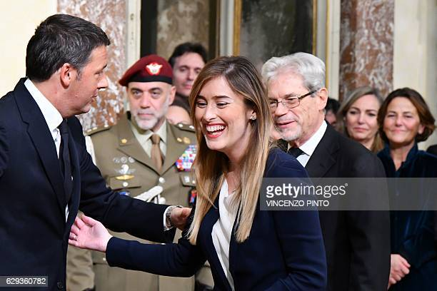 Former Prime Minister Matteo Renzi welcomes Undersecretary to the Prime Minister Maria Elena Boschi during the swearing in ceremony of newly...