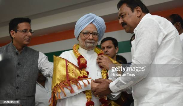 Former Prime Minister of India Manmohan Singh felicitated by Karnataka Pradesh Congress Committee as Randeep Surjewala Congress spokesperson looks on...
