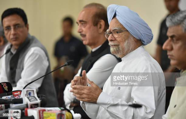 Former Prime Minister of India Manmohan Singh with Congress spokesperson Randeep Surjewala and Ghulam Nabi Azad the leader of the Opposition in Rajya...