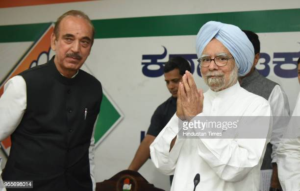 Former Prime Minister of India Manmohan Singh with the Rajya Sabha Leader of Opposition and Congress leader Ghulam Nabi Azad during a press...