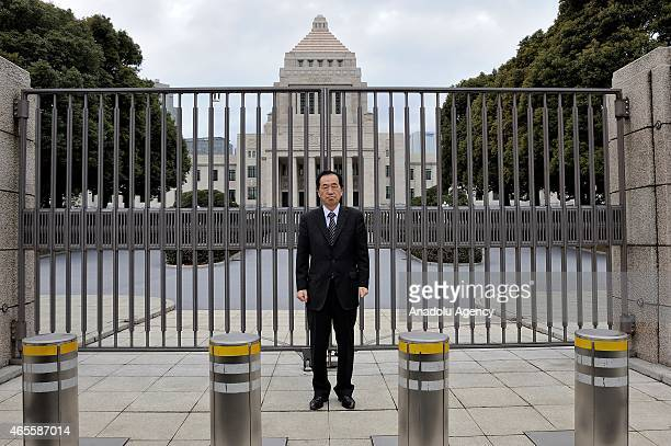 Former prime minister of Japan Naoto Kan attends a antinuclear rally in front of the Diet building in Tokyo Japan on March 08 2015 While Japan will...