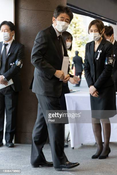 Former Prime Minister of Japan Shinzo Abe wearing a face mask arrives at the National Theatre of Japan to attend the national memorial service for...