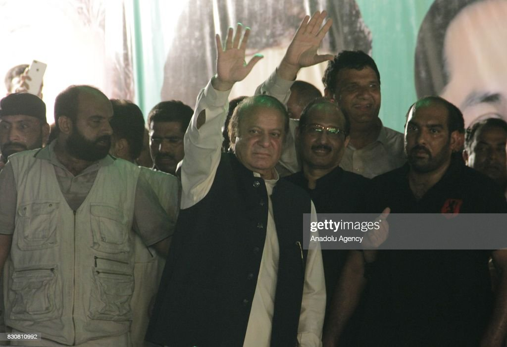 Former Prime Minister of Pakistan Nawaz Sharif greets his supporters as he arrived in Lahore from Islamabad during a rally in Lahore Pakistan on...
