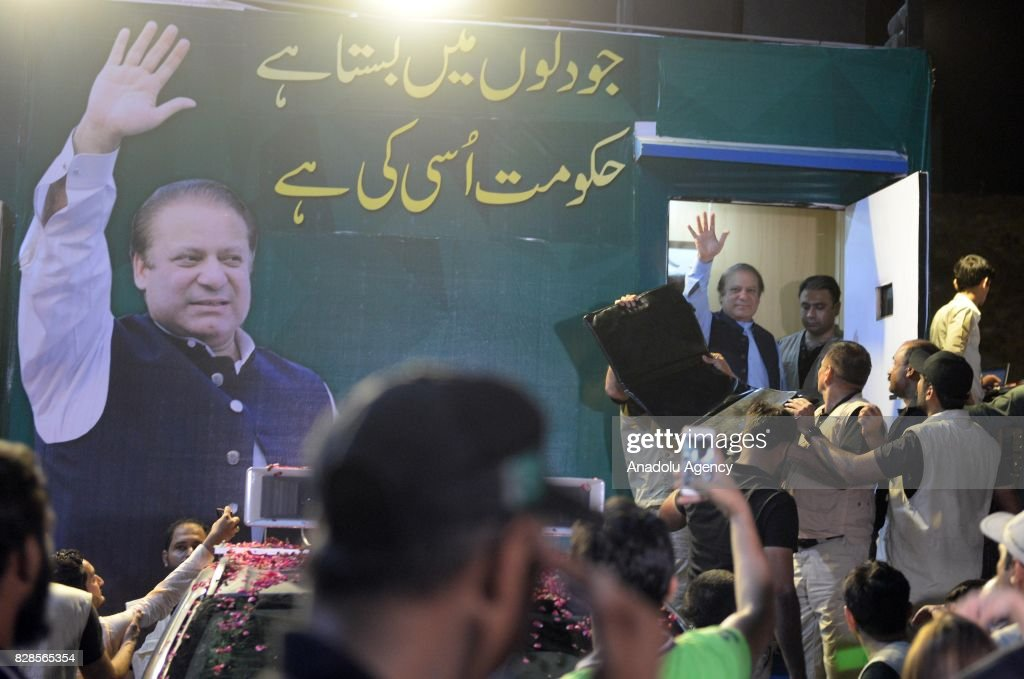 Former Prime Minister of Pakistan Nawaz Sharif waves as he comes out from a container after delivering a speech to his supporters during a rally in...