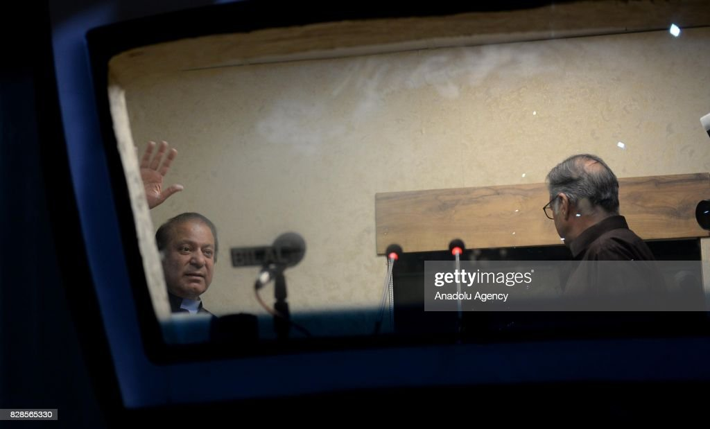 Former Prime Minister of Pakistan Nawaz Sharif waves before delivering a speech to his supporters at a container during a rally in Rawalpindi...