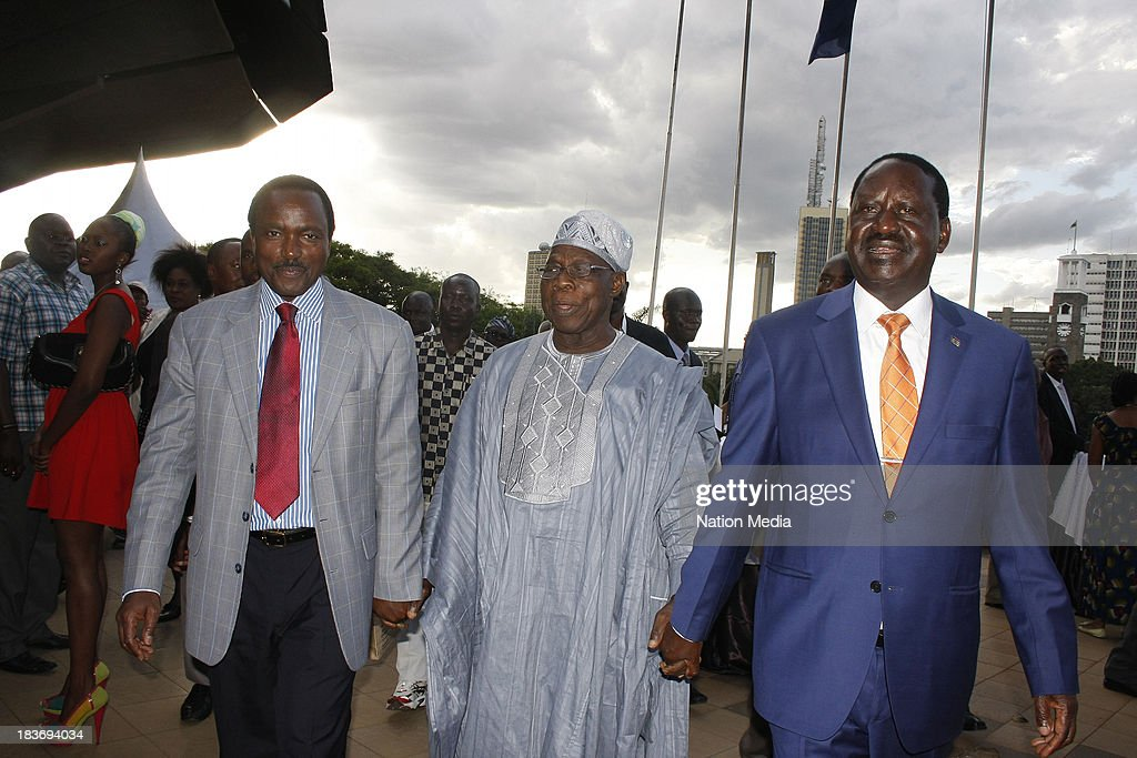 (Not for sale to The Star (Kenya), Capital FM, The People, Citizen TV, Kenya Broadcasting Corporation) Former Prime Minister Raila Odinga with former Nigerian President Olusegun Obasanjo, former vice president Kalonzo Musyoka during the launch of his autobiography on October 6, 2013 at the KICC in Nairobi, Kenya. The Flame of Freedom takes an indepth look at the former Prime Ministers life journey; most importantly his political struggles.