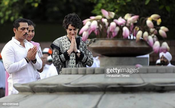 Former Prime Minister Rajiv Gandhi's daughter Priyanka Gandhi along with her husband Robert Vadra and daughter Miraya paying floral tribute during a...