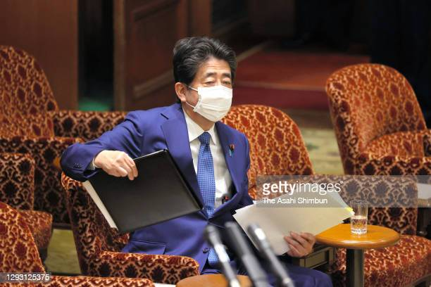 Former Prime Minister Shinzo Abe is seen after attending the Lower House Rules and Administration Committee for damaging the trust of the Diet by...