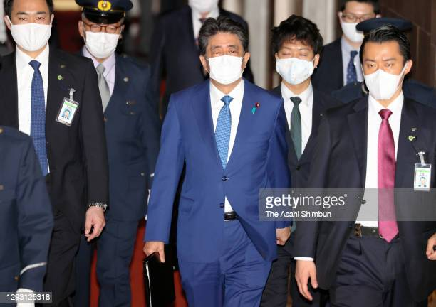 Former Prime Minister Shinzo Abe leaves after attending the Lower House Rules and Administration Committee for damaging the trust of the Diet by...