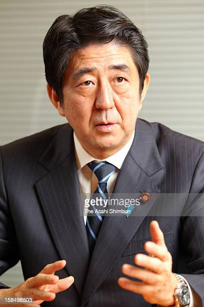 Former Prime Minister Shinzo Abe speaks during a The Asahi Shimbun interview at the Liberal Democratic Party headquarters on December 20 2011 in...