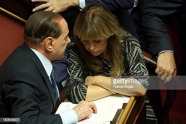 Former Prime Minister Silvio Berlusconi chats with Senator Alessandra Mussolini during the confidence vote for Enrico Letta's government at the...