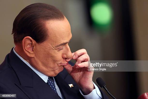 Former Prime Minister Silvio Berlusconi closes his mouth after a question as he attends the launch of the book 'Sale Zucchero e Caffe' by journalist...