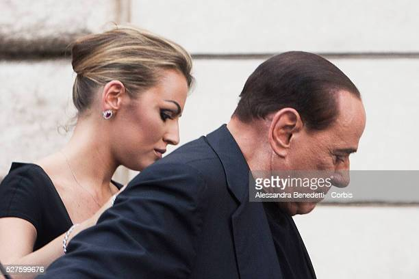 Former Prime Minister Silvio Berlusconi, is flanked by his new girlfriend Francesca Pascale, during a Pro-Berlusconi rally outside his Rome...