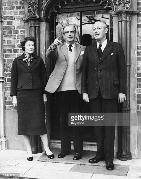Former Prime Minister Sir Anthony Eden and his wife with current Prime Minister Harold Macmillan at the Eden's home in Berkshire England March 16th...