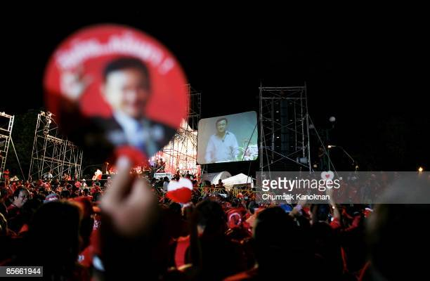Former Prime Minister Thanksin Shinawatra gives a live address to his supporters outside Government House during a protest on March 27 2009 in...