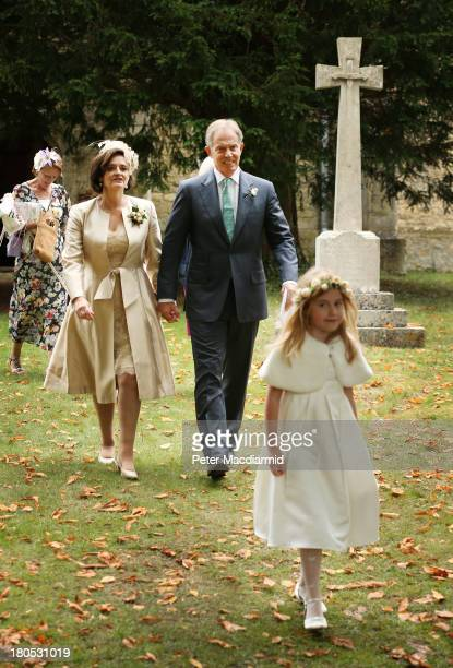 Former Prime Minister Tony Blair and his wife Cherie leave All Saints Church after attending the wedding of their son Euan Blair to Suzanne Ashman on...