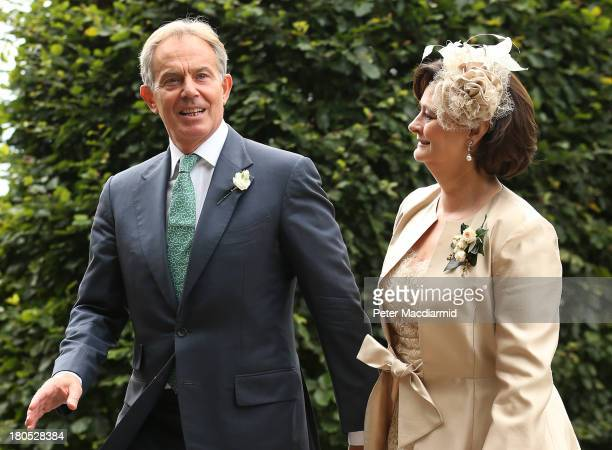 Former Prime Minister Tony Blair arrives withh his wife Cherie at All Saints Parish Church for the wedding of Euan Blair and Suzanne Ashman on...