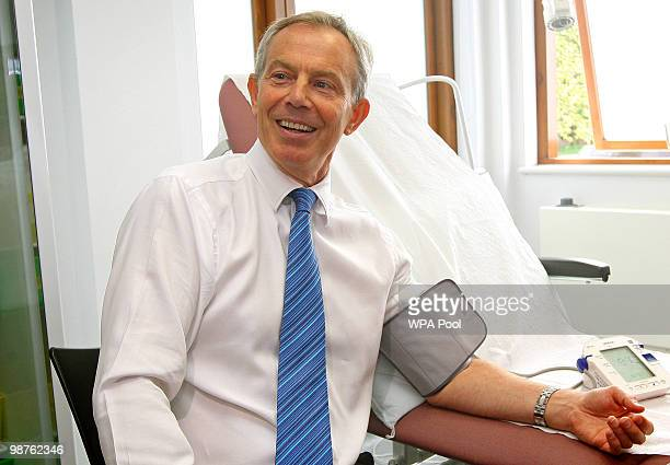 Former Prime Minister Tony Blair has his blood pressure taken by Nurse Paula Martin during a visit to Alexandra Avenue Health and Social Care Centre...